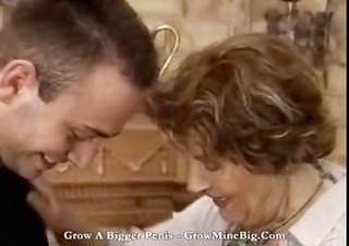 Mature brunette granny goes for a young cock and