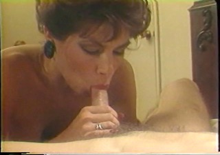 Mature blonde sucks on a big white cock in her